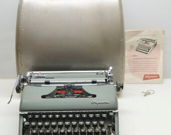 Vintage 1955 Olympia SM3 De Luxe Green Typewriter, NEW Ribbon, Working Beauty in Case with Instructions and Key, made in Germany,