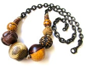 RESERVED - A Thing or Two about A Thing or Two - primitive tribal chunky assorted vintage wood beads, waxed hemp, black brass chain necklace