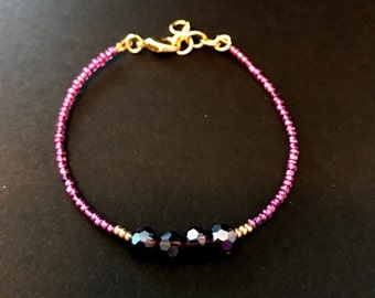 Purple and gold seed bead glass bead bracelet