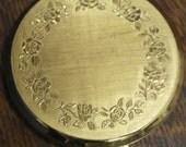 vintage brass rose decorate stratton powder compact