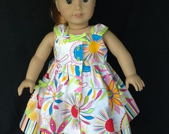 18 inch doll sundress and hair clip. Bright floral cotton with contrasting stripes.  Daisy Kingdom pattern.