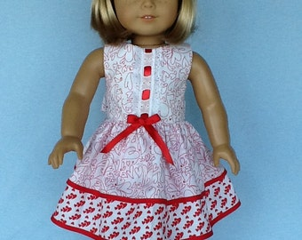 18 inch doll Valentine's Day dress and hair clip. Sleeveless double ruffled dress.