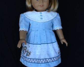 18 inch doll dress. Fits American Girl Dolls.  Blue Daisy Kingdom border print.