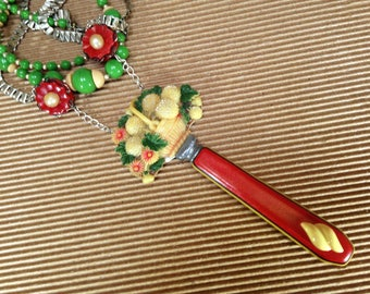 Refashioned vintage jewelry Art Deco Bakelite era flatware celluloid brooch antique glass bead necklace red green butterscotch statement