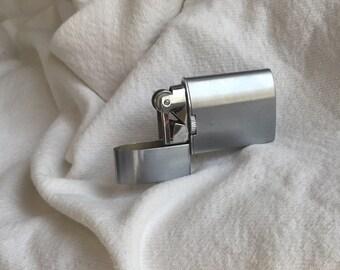 Vintage Swank windproof lighter cigarette lighter Japan modernist chrome 1950s 1960s prow of ship shade