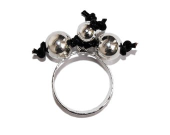 Sterling Silver Ring Adorned with Sterling Silver Beads and Leather