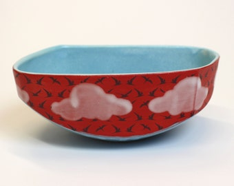 Red sunset Bowl with birds and white clouds