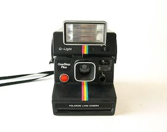 Vintage rainbow stripe Polaroid land camera with Q light flash