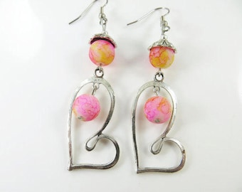 Uneven heart earrings in pink and yellow