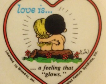 "LOVE IS......a feeling that glows""  vintage sticker, 1970"