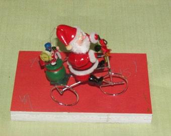 vintage large Kirt Adler Santa ornament  Santa on a bike 1983