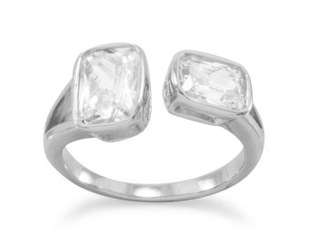 Rhodium plated sterling silver split style ring with 6mm x 8mm and 5mm x 7mm rectangle CZs.  This ring is available sizes 5 - 9
