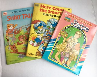 Lot of vintage coloring books feom the 1980s! Barbie, Here comes the Smurfs, and Shirt Tales. Retro 80s toys activities