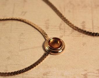 Avon Simulated Topaz Dazzle Dot Necklace Gold Tone -  Vintage 1986