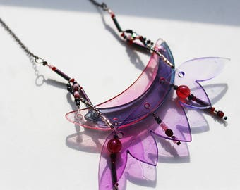 purple plexiglas necklace,delicate, whimsical, fairy, abstract butterfly flower, reflecting colorful, fashion statement jewelry