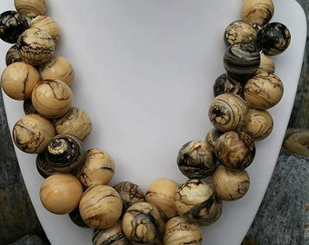 Ivory, necklace made with hollow blown beads