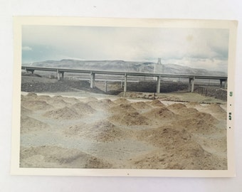 vintage color curious land masses polaroid with highway overpass