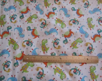 White with Multicolor Dinosaurs Flannel Fabric by the Yard