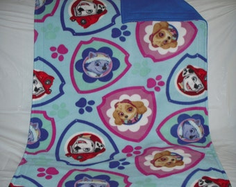 Doggy Blanket - oh so cute Paw Patrol pets print fleece with solid royal blue fleece on the reverse side.