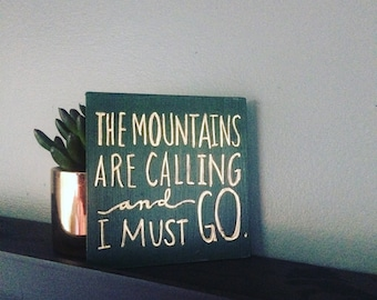 The Mountains are Calling Quote on Wood