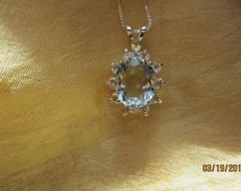 Exquisite Natural Oval Brazilian Aquamarine Accented with Crystal White Sapphires