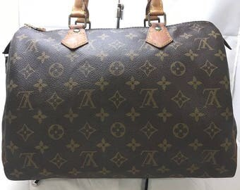 Authentic Louis Vuitton Monogram Canvas Leather Speedy 30 Handbag.