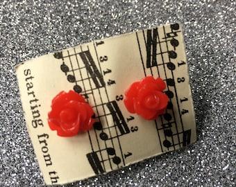 red resin flower earrings
