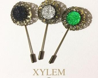 Men's dandelion brooch.