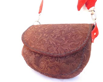 soft beautiful brown carved leather bag