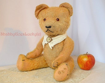 Antique teddy bear, German made in the 1920s or 1930s, yellow mohair, 16 inches tall well – loved old teddy bear, with vintage photo brooch