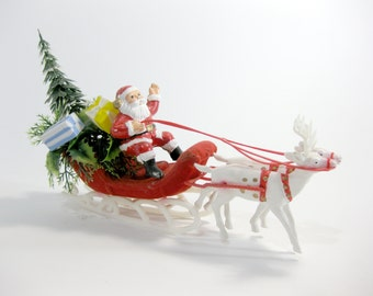 Vintage Christmas Santa with Christmas Tree and Christmas Presents in Flocked Sleigh with White Reindeer ~ Plastic