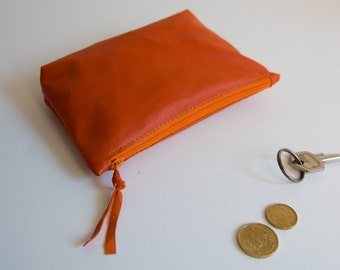 orange cosmetic pouch with zippered pouch cosmetic bad of smooth genuine leather smartphone case