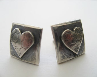 silver heart stud earrings with net texture