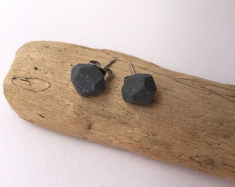 Concrete inspired, dark grey eco-resin faceted earrings with flecks of glitter highlights. Surgical steel studs.