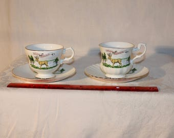 A set of 2 different vintage Souvenir tea cups and saucers from Minnesota, same logo, made in England for Enco National NYC, fine bone china