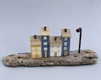 Four little painted houses on unusual wormed British driftwood #576
