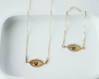 Bracelet en gold-fill avec chaîne marquise et oeil protecteur en laiton plaqué
