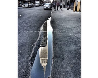 Reflection of the Empire State Building in a puddle NYC, Original photograph