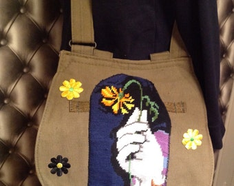 Messenger bag decorated with flowers and vintage canvas military