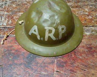 Reserved for Jackie- Vintage child's A.R.P. Air Raid Precautionary military helmet: well loved condition