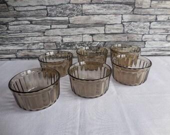 A set of 6 smoked glass ramekins Arcopal the ramekins have the BP logo on the base