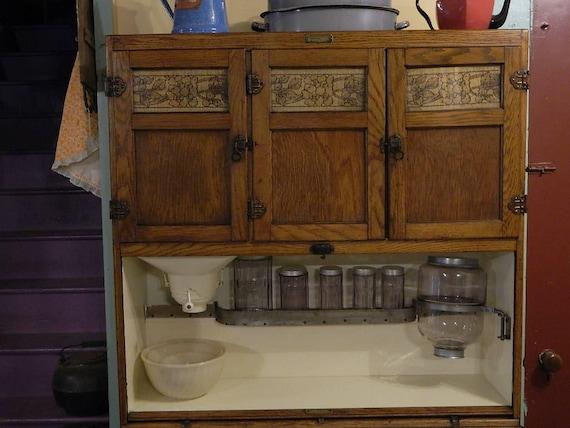 1917 Oak McDougall Hoosier Cabinet with original finish door