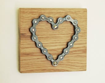 Bicycle chain heart on oak