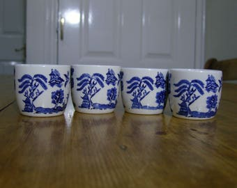 A Set of Four Willow Tree Pattern Egg Cups