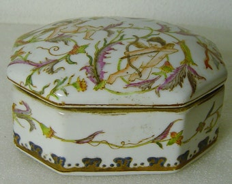 vintage lidded fajance box with angels signed Toussi Court
