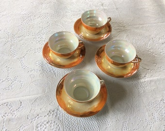 4 Fine china tea cups and saucers.