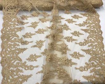 Gold paisley flower embroider and corded with a metallic gold tread on a mesh lace-wedding-bridal-prom-nightgown-decorations- sold by yard.