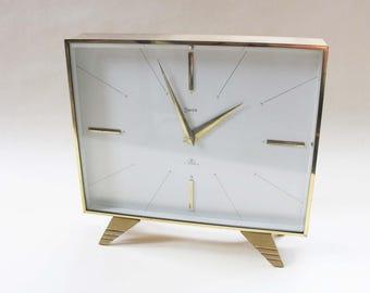 Vintage brass Swiza mid century modern clock. Elegant and sleek slimline design, very stylish.