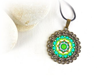 Buddhist necklace with Anahata chakra mandala, Star of David at the center and sacred geometry elements; gift idea for a friend.