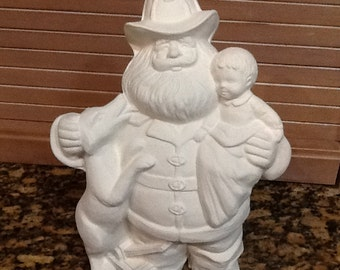 Ceramic bisque Fireman Santa clause